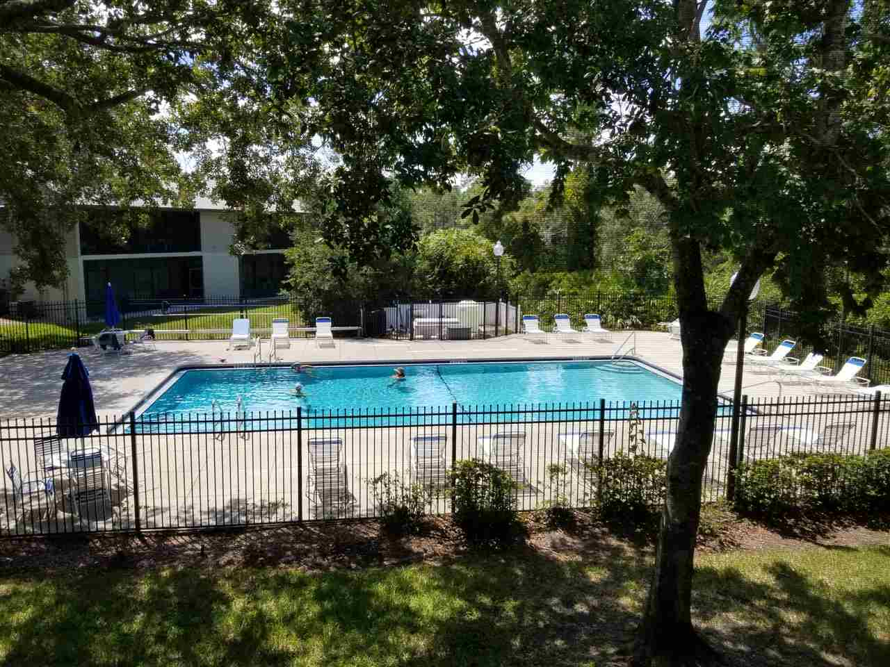 Kick back on your private screened balcony and view the woods and a full view of the pool. It is like living in a tree house. The condo has  new carpet and newer stove, refrigerator, water heater, light fixtures and screens. Very spacious 2nd floor unit has been meticulously maintained.  Washer and dryer in closet off of the balcony and are included. This is an Intracoastal community with 3 pools, 1 always heated, tennis and nature trails. The community boat dock is just steps away as is a park.
