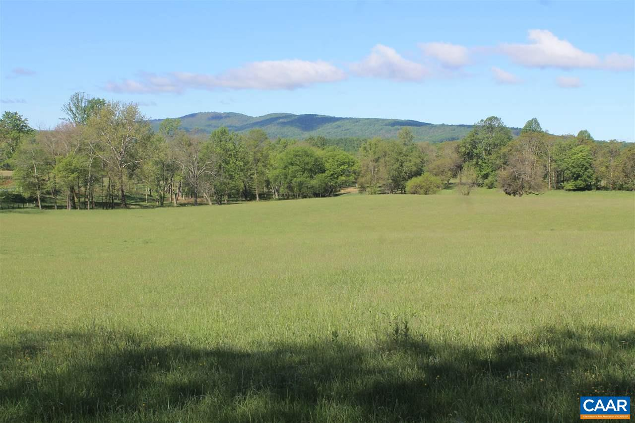 17 acre parcel of open, gently rolling pasture or hay land is ideal for development into a small horse farm.