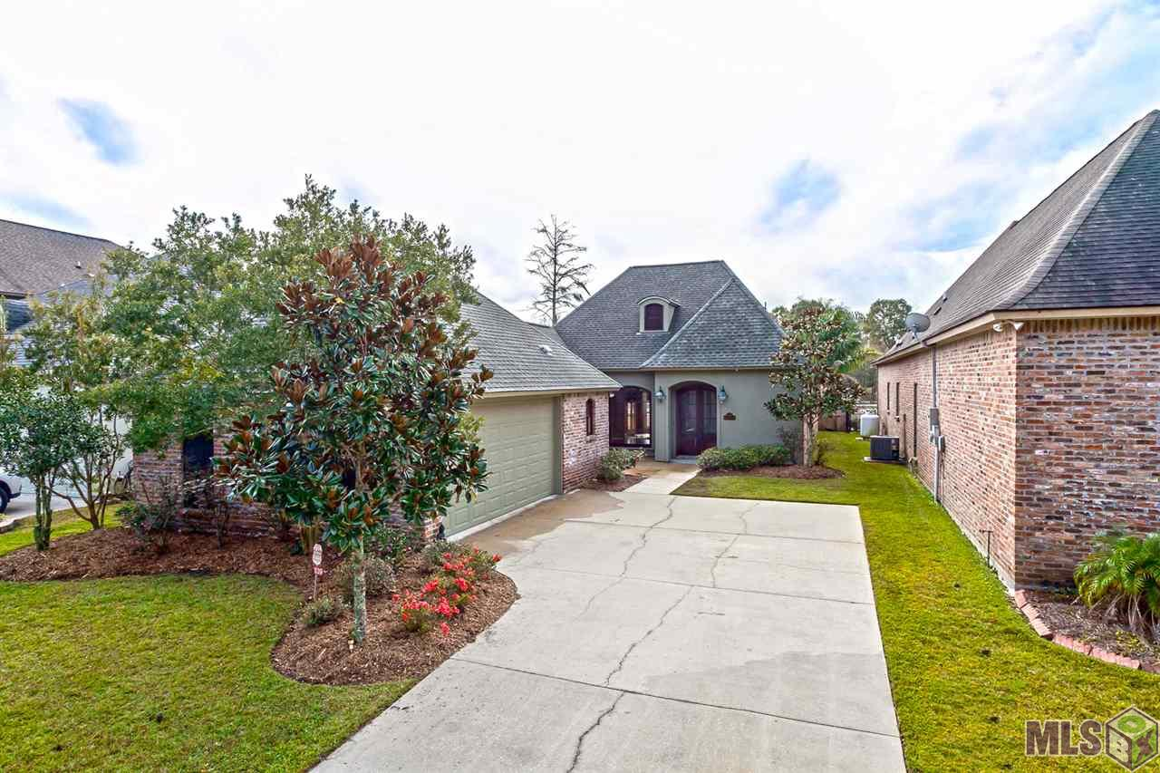 Welcome to resort living! Come home to a beautiful house with high ceilings, triple crown molding, Cypress wide plank floors throughout the main living area, with tumbled tile floors throughout the wet areas like kitchen and baths. Stainless appliances and custom cypress cabinets grace an eat-in kitchen with a beautiful view of the pool and the canal. A magnificent outdoor kitchen over looks the beautiful saltwater pool and diversion canal.  Entertaining is easy with TVs in the living room and outside. There is also surround sound and a major large fireplace with huge mantle perfect for that extra large flat screen TV. Gas log fireplace is perfect for those chilly nights too. Start every morning with a beautiful view and separate entrance from your master bedroom to your pool sauna and of course the diversion canal. Master bath has separate shower huge jetted soaker tub, separate vanities, and grand closets.