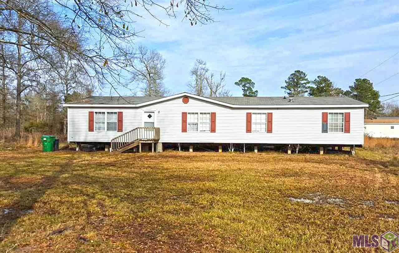 INVESTORS, Handy Men if you are looking for a great opportunity, a great property then this is it. 2 beautiful acres in the heart of Watson. 4 bedroom 2 bath 1914 Sq foot Double wide Mobile Home. Mobile Home is in need of some repair. Priced below appraisal. Appraisal was conducted in March of 2015. Live Oak Schools.  *New Air unit interior installed March of 2015 and exterior unit installed 2014. All appliances are included.