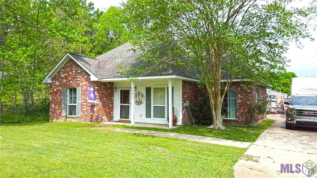 NO FLOOD REQUIRED!!! EAST ASCENSION SCHOOL DISTRICT, WOOD VENTED FIREPLACE, SPACIOUS FLOOR PLAN. SOME HARD WOOD FLOORING. LARGE DOUBLE CARPORT. 6 FT PRIVACY FENCE. 18X24 ABOVE GROUND POOL. NICE UPPER AND LOWER WOOD DECKS. DEAD END STREET. NICELY LANDSCAPED.