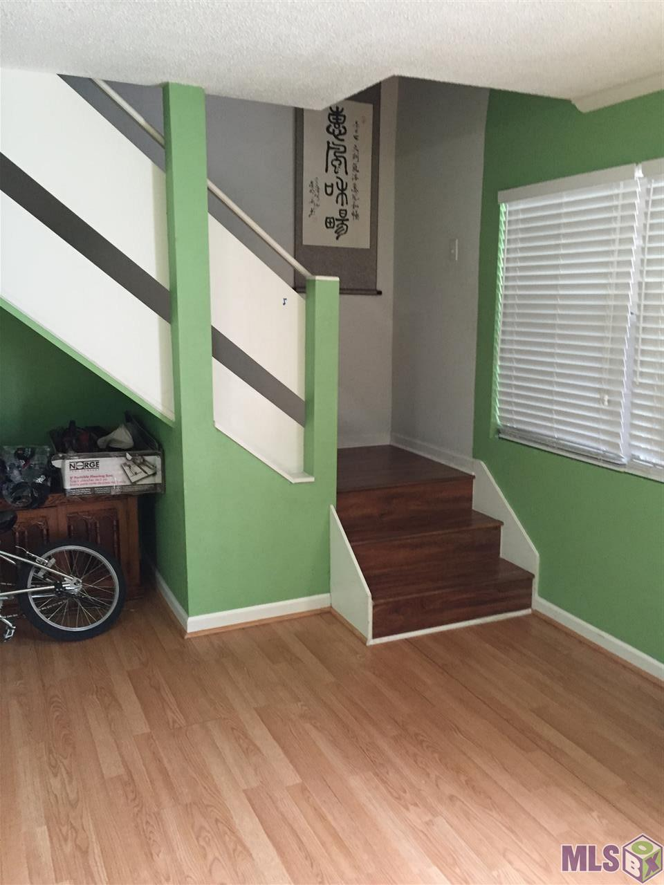 Enjoy being in this gated community, near LSU, and on the bus route! What a great value for a three bedroom two bath right near the pool. There is no carpet in the house! There are several huge walk in closets. It's perfect for LSU students looking for a convenient place to live.