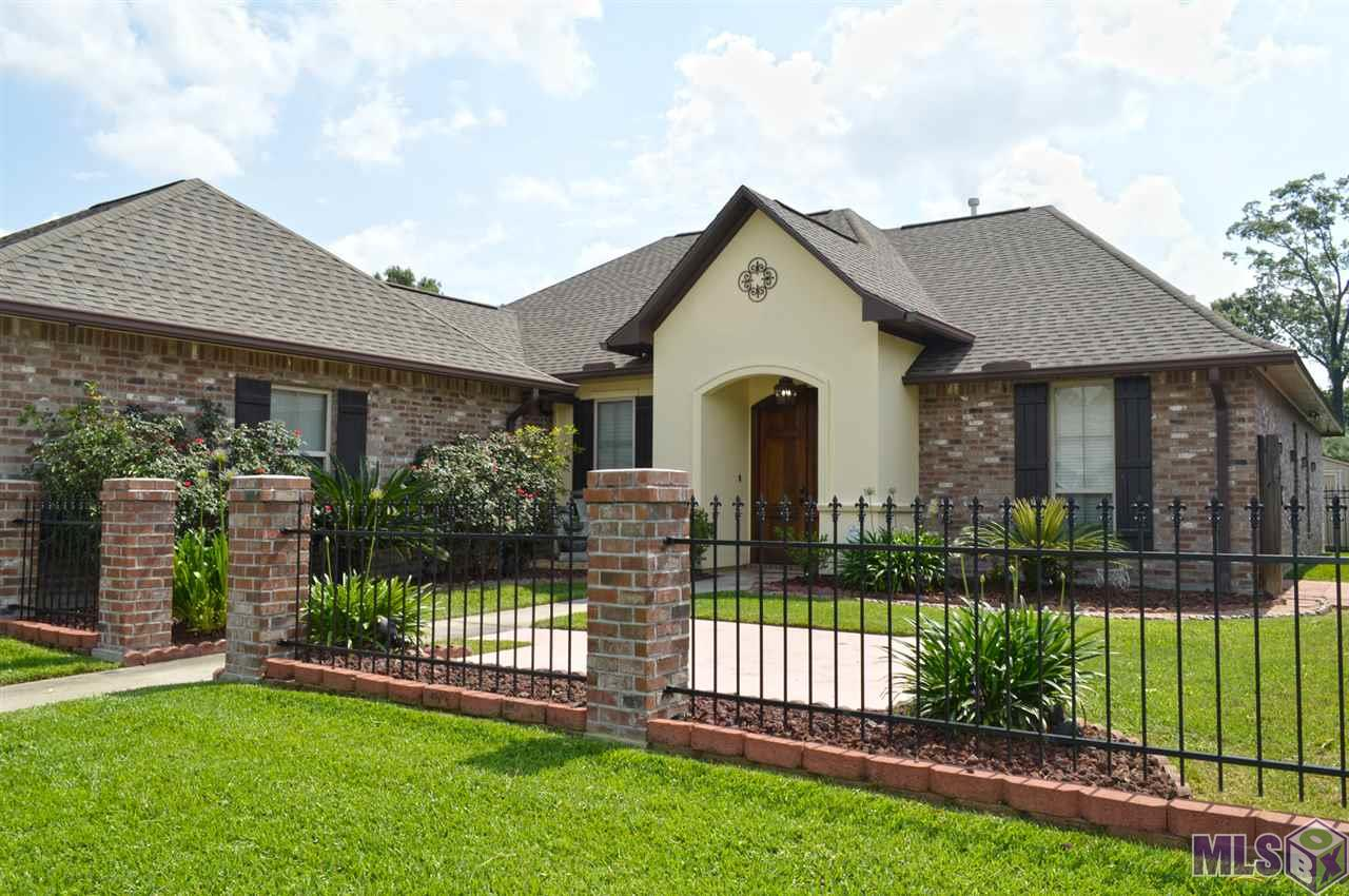 Great location, NO FLOOD INSURANCE REQUIRED, no carpeting, and YES it is move in ready!!! Open floor-plan with wood floors throughout main living area and sensible title in the wet areas, like kitchen and baths. Cypress kitchen cabinets grace the eat-in kitchen with a GAS STOVE!!! Excellent view of the fully fenced backyard from living room and kitchen. Smart layout with two bedrooms on one side of the house and two on the other side. Charming gas log fireplace and an impressive out door kitchen. Over the top curbside appeal with divine courtyard in the front. Wired to the high tech person's dream: surround sound, security system and cameras, as well as solar fans in the attic to help keep things cool!
