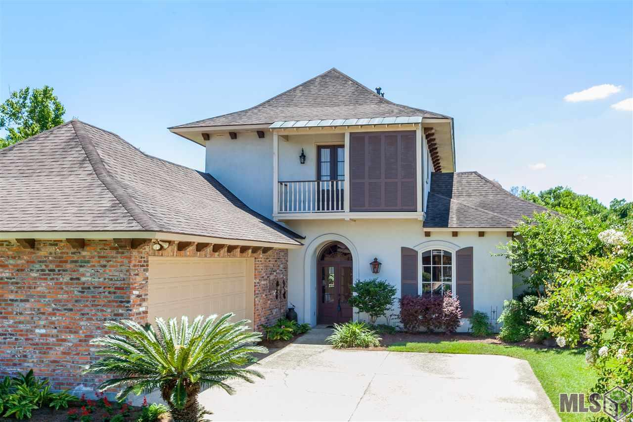 Overlooking the 2nd green of the Santa Maria golf course, this home has it all.  Lovely kitchen keeping room with super sized work island, walk in pantry and lots of natural light streaming in.  Archways to the family room which includes a butler's pantry/wet bar with a pass through window, perfect for entertaining, fireplace with built-ins on both sides and a bank of windows overlooking the golf course.  Nice patio to have morning coffee.    Master suite has H/H vanities, jetted tub, walk-in shower with glass blocks.  Huge master closet with lots of storage. An additional bedroom is downstairs with its own full bath.   Super-sized utility room with mud sink.   Upstairs has 2 bedrooms (with balconies) with full bath.  Also, a large bonus/game/rec has an incredible balcony with stunning golf and water views.  Heart pine flooring in the foyer, dining room and family room. Seller is providing an Old Republic Home Warranty protection for your peace of mind.  THIS HOME DID NOT FLOOD!!