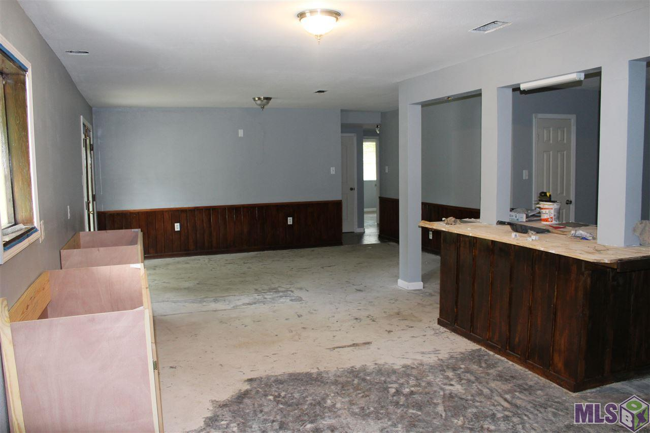 A little more TLC and this will be a great home for a large family or a profitable duplex for a buy and hold investor! Great bones and partially renovated - just waiting on you!