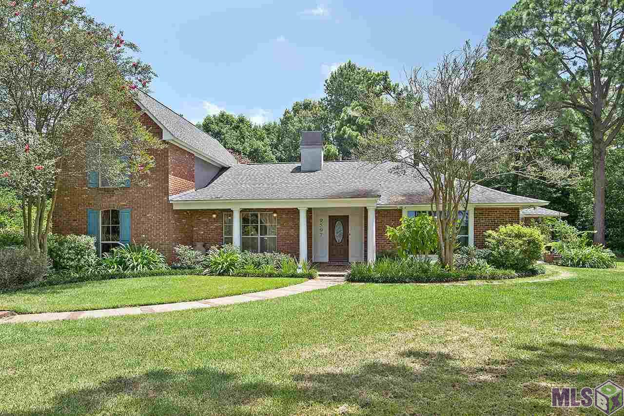This prestigious piece of property has been the home of only one family since established. This charming four bedroom three and a half bath is situated on approximately 1 acre, nestled on the LSU lakes with multiple lake views. Featuring a large backyard with a private entrance and included in the property is a full in-law suite, perfect for multi-generational families or can be used for a live in Nanny or live in help of any kind. It has its own private entrance, ceramic tile floors, granite counter tops, full kitchen, living and dining area and exclusive patio to enjoy the cool breeze which encumbers the LSU lakes. The main part of the home features a large formal dining area with wood floors, open living area to the breakfast and kitchen. The living area features a huge bay window, wood burning fireplace and raised hearth with oak mantel. The kitchen has an abundance of cabinets for storage needs, granite counter tops with tumble stone back splash, ample counter space, large island with sink and an enormous walk in pantry. Also included is an office / library with gorgeous oak built-ins and a 19.5 x 23.3 game room. The large master suite is located on the main floor. Boasting wood floors, two large walk in closets with built-ins, soaker tub, separate shower and dual vanities. There are two guest bedrooms and one bath on the second level. Included with this property is a 36 KW generator, workshop, double pane high efficiency windows, 3 separate AC and R-19 blown insulation throughout. This home is truly a rare find and owners would love to pass this property onto a new family to enjoy for generations as did their family.