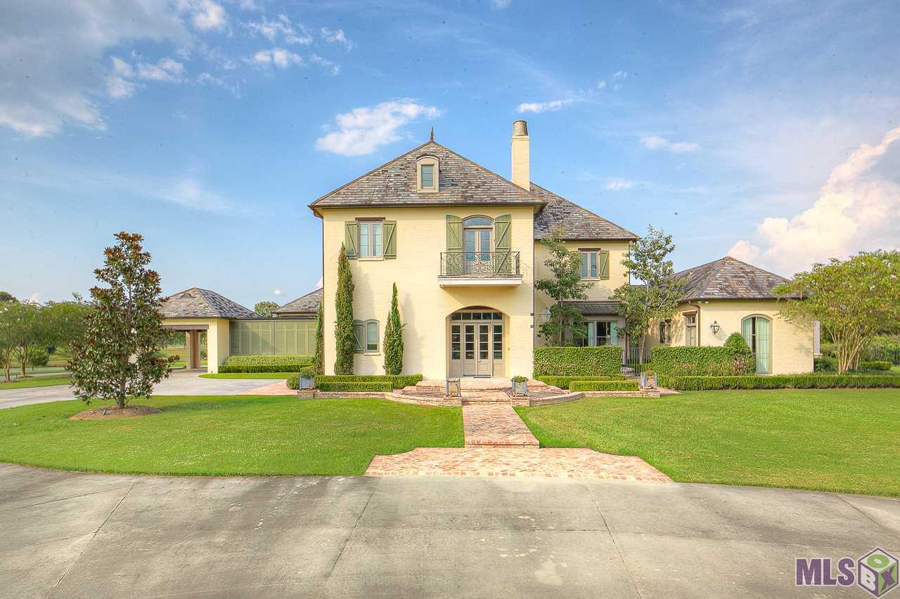 "MOST DEFINITELY ONE OF THE TOP 10 HOMES IN THE BATON ROUGE AREA!!   Custom designed home by renowned Louisiana architect Al Jones and meticulously built by the owners over a two year period.  Raised high (did not have any water in flood of 2016) on top of this 13.59 acre parcel, overlooking two ponds, a fenced horse area, and the large Mallard Lake, views from all windows are stunning!  All ""French Fieldstone"" floors were shipped in from France and installed in a 6"" mortar bed, , all (31) old cypress beams and flooring handpicked for the job, massive baseboards, moldings, all specific to this one of a kind home.  The handsome three level hand forged wrought iron stair railing is so gorgeous as it winds around the solid stone feature, the finest craftsmanship only!  Some of the other spectacular features include: the real thing ""Al Jones white washed"" (special blend) exterior finish, all foam insulation (open and closed cell), hand plastered kitchen hood, keeping room and living room fireplaces, 4 ""real masonry"" fireplaces in the home,  all solid cypress doors throughout the home, tasteful ""Russell Pool"" and hardscape/landscaping designed and installed by Eduardo Jenkins overlooking formal gardens, antique fountains and water features. The lifetime slate roof and a whole house (48 kw) generator will keep you safe and warm (or cool) during  in-climate days. The master suite and private his/her bath and dressing areas are so luscious, staying home will be a treat.  Gorgeous oversized kitchen features a massive marble island, Sub Zero, Wolf and Kitchen Aid products with fantastic marble Butlers area and separate pot/pans, food and china pantries. A large rear screened porch includes masonry fireplace, outdoor kitchen and grilling areas, the perfect spot for watching the game with friends or use an overflow area when entertaining during large events.  Lots of space to erect a barn for your horses, plans that the sellers have in possesion ready to share with you!"