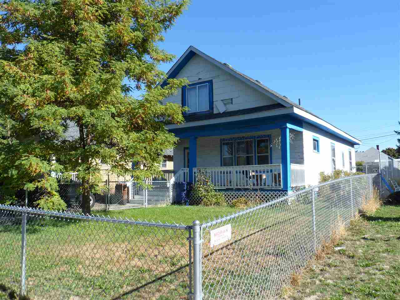 Spacious 1908 Bungalow fixer in nice NE pocket. Big front porch, large entryway with built ins, high ceilings, large living & formal dining rooms. Main floor laundry room, stairs to attic that could be finished. New gas furnace & hot water tank. Roof looks good, completely fenced front & back.