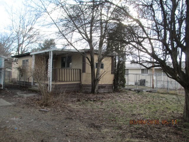 Sold as is cash only!  2 bed 1 bath 624 square foot manufactured home with a large detached garage / shop!