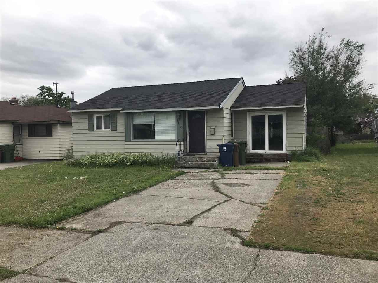 Adorable home very spacious 136 sq ft on the main floor with a sun room and 2 main floor bedrooms the master suite is in the basement.  New Comp roof, newer furnace gas forced air, vinyl windows, gas stove. Fully fenced backyard with alley access... Dont miss this one.