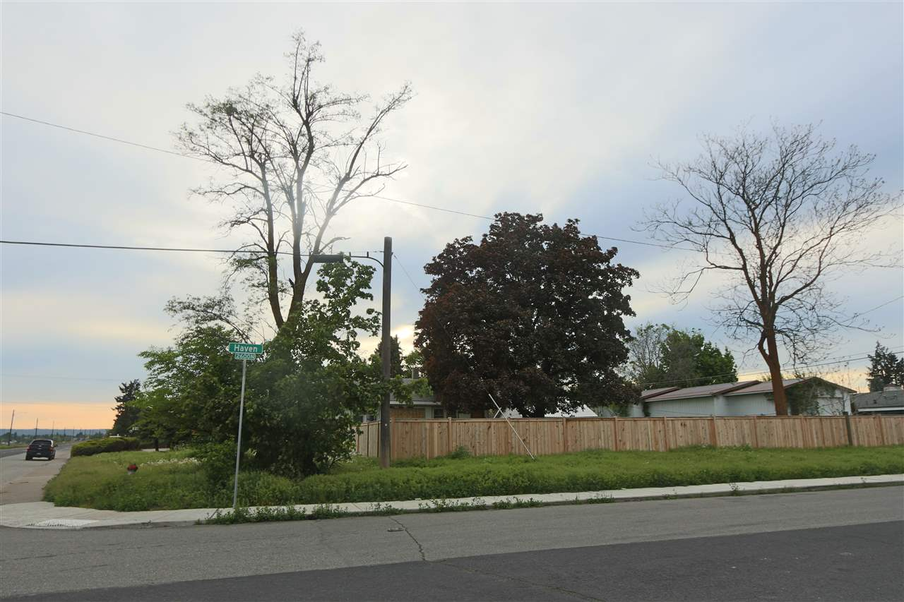 VIEW.   Level corner lot with all utilities available.   Fenced.   Zoned for single family home. 10 minutes to I-90.  Short term contract terms available.    According to City, water is available in both streets; sewer is available in side street...Buyer to verify.
