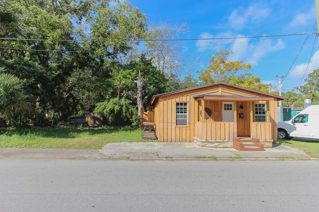 Investor alert! Located near the corner of W. King St. & S. Whitney St, this 1925 cottage with CM-2 (Commercial Medium) zoning has been completely restored. It is ready for use as a single family home and also allows for many uses including, but not limited to, salons, retail & service establishments, home office, etc. The home is currently designed as a 1 bedroom, but can be converted to a 2 or even 3 bedroom home as originally designed. There is a large back yard that also extends south