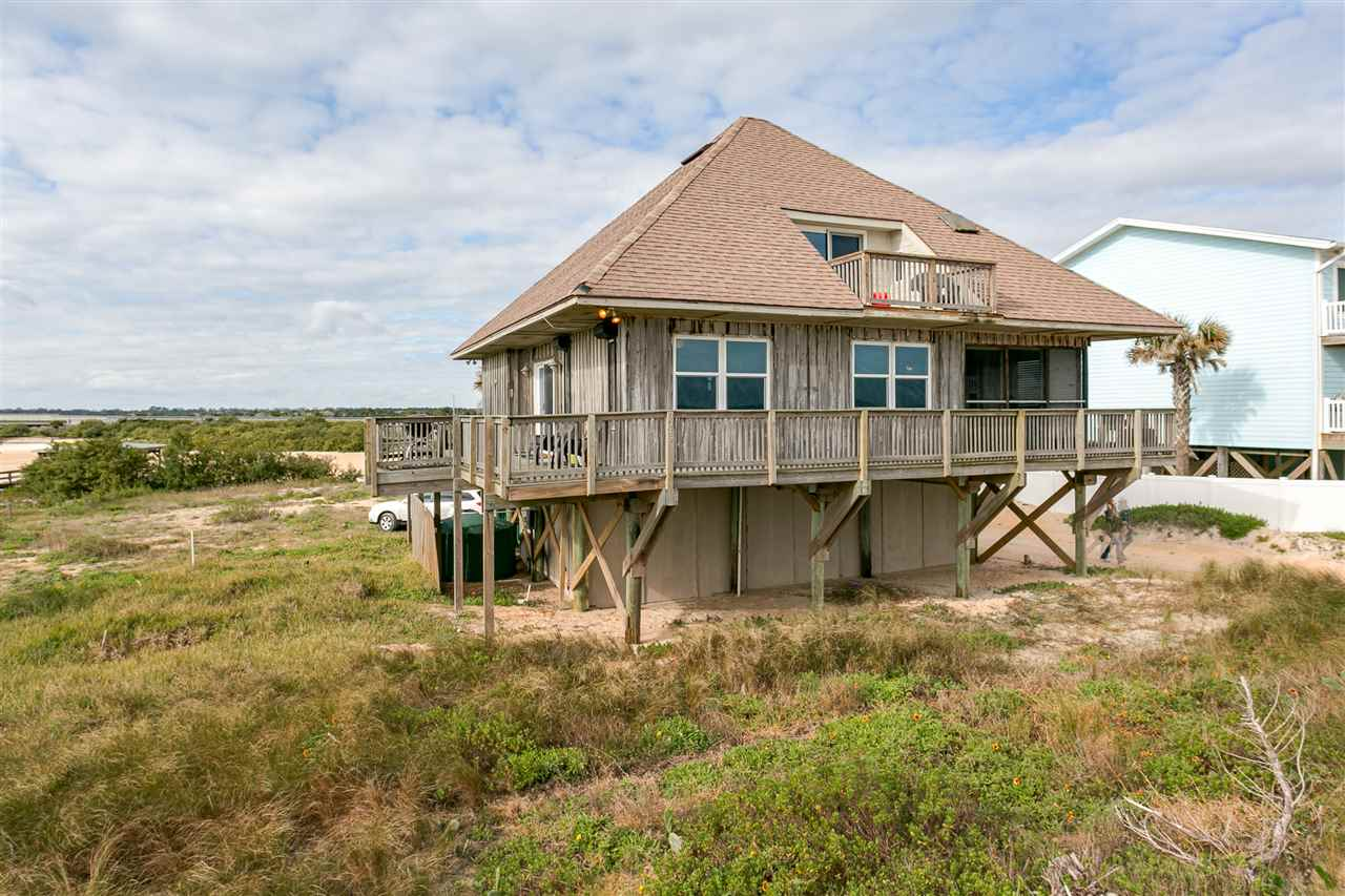 Million Dollar views for 799k -Classic 4x4 beach living. Best of both worlds - Summer Haven home has direct oceanfront and waterfront on Summer Haven River. 2/2 with great room, wrap around porches and two upper decks. Home built on pilings in 1981 and permitted by Florida Dept. of Natural Resources. The home is seaward of the Coastal Construction Control Line. Water source is with an artesian well and reverse osmosis system. There is a dock on the river