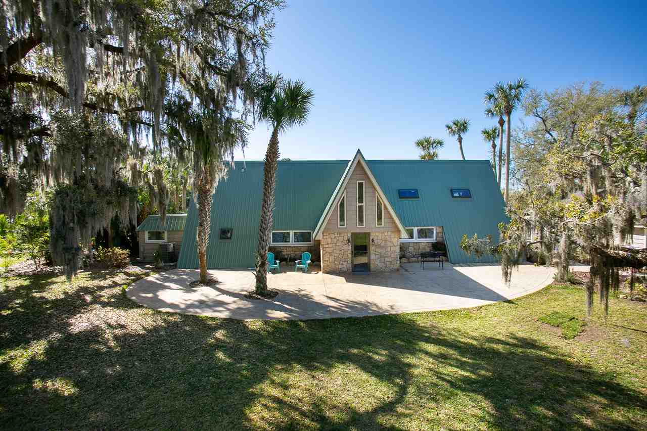 250' waterfront compound (over 1 acre) on Fox Cut  - yards away from Intracoastal with protected boat dock + lift. Truly unique A Frame pool house. Remodeled for comfort but still has the original charm of coquina walls, cypress cathedral ceilings, exposed beams, and oak floors. The large family gathering room downstairs features a fireplace and views of pool and Intracoastal waterway. The master suite is downstairs as well. A 2 car detached garage with an air conditioned room over makes for a