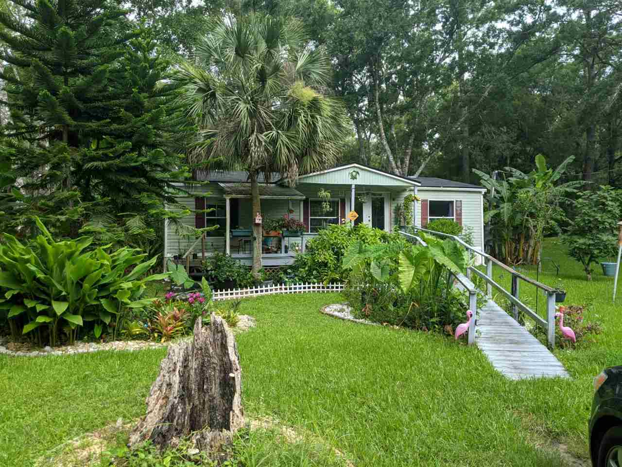 2 very well maintained mobile homes on 2+ acres with gorgeous oaks. Each home is 3 beds 2 baths and both are move in ready. Current tenants have leases through next March.
