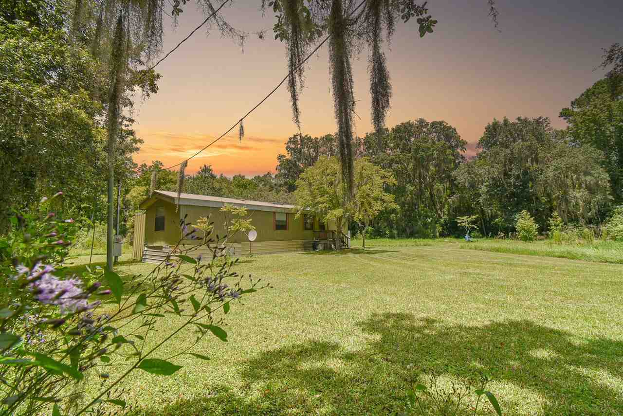 """2 mobile homes on 2.96 acres in St. Augustine. The property has lots of beautiful large oak trees with Spanish moss, giving it an """"old Florida"""" feel. If you want to be close to downtown, shopping, and dining, but still live privately, this is the perfect property. Conveniently located between St. Augustine and Jacksonville, this is a wonderful area for families or an investor looking for rental income. Build your dream home or keep the 2 homes that are currently there."""
