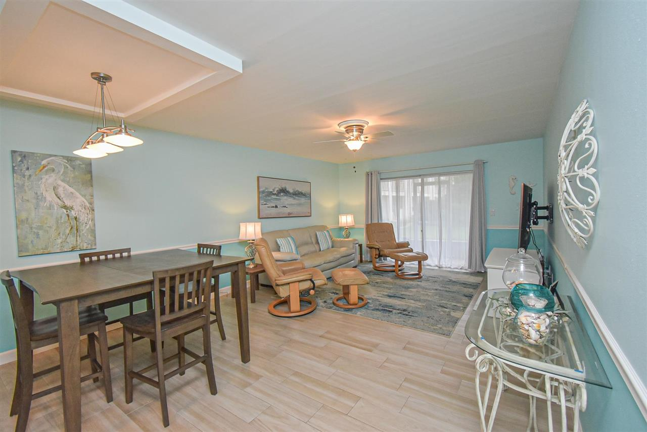 Pool side first floor unit. 2/2, beautifully updated, painted, and fully furnished. Tile flooring throughout and stainless steel appliances. New, luxury master bathroom. Beautiful blue paint throughout unit that adds to the beachy feel. Presently on the Four Winds on-site rental program. Nothing to do but enjoy!