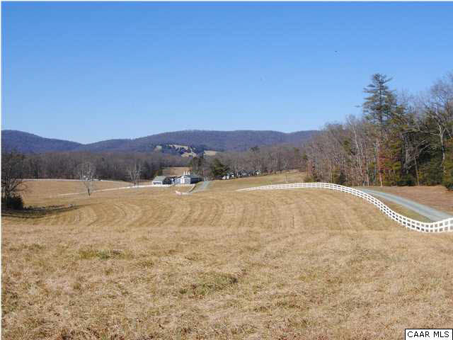209+/- acres located in the beautiful Keswick hunt area of Albemarle County. The land has numerous building sites with wonderful views of the southwest mountains. Existing improvements include, 4 tenant/guest homes, stable complex and cattle barn. The property has a mix of open pastures and hardwood forest.