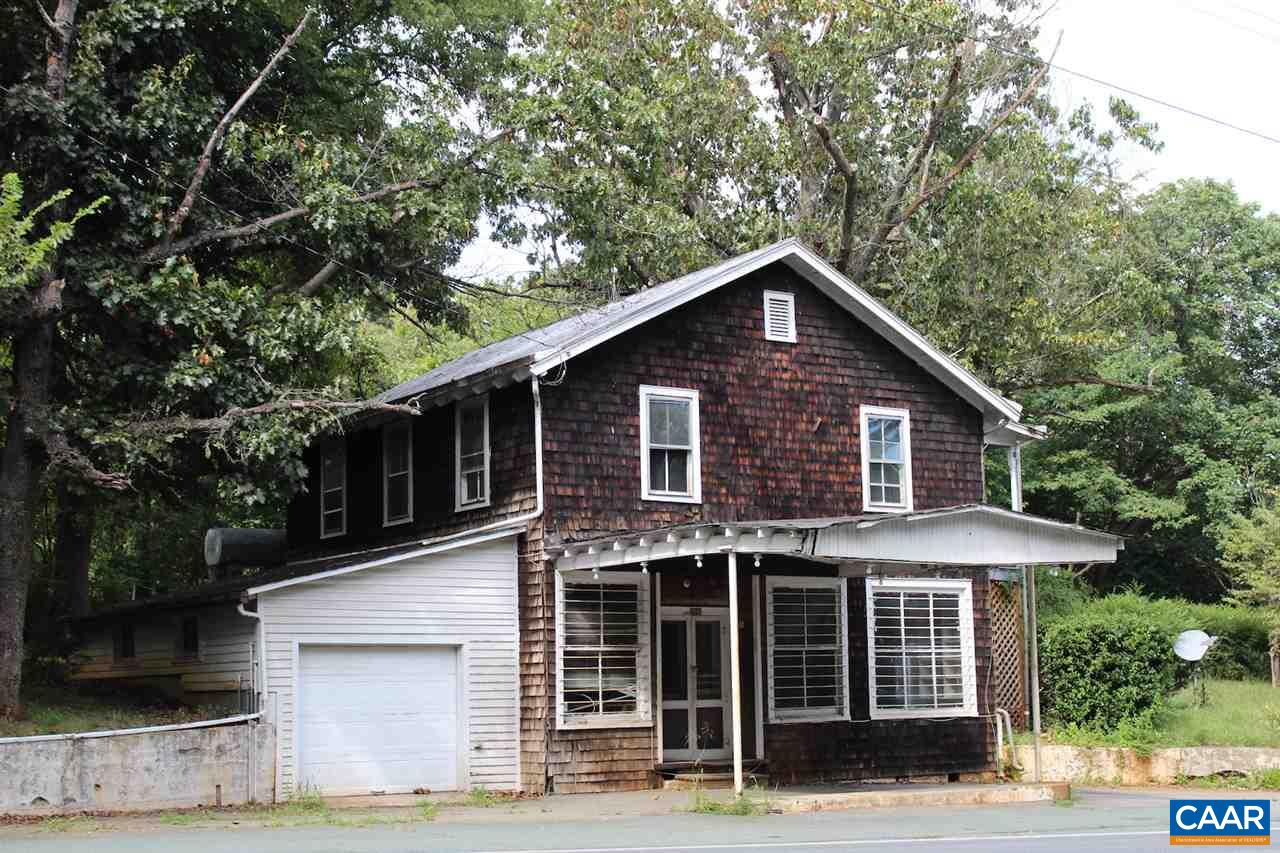 First time offered for sale to public. This Former Furniture Store on Route 29 South could host multiple uses. Live above and run business below. Great old hardwood floors on all levels. Basement area has built-in cabinets for storage or display. Garage could be used for additional space or storage.