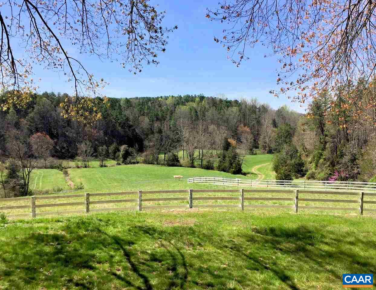 Convenience, privacy, and stunning views are yours with this turn-key 237 acre horse farm in Earlysville.  The well maintained farmhouse overlooks lush pastures, productive hayfields, hardwood forests, and Beaver Dam Creek which traverses the property. Several excellent homesites offer gorgeous year round mountain views.  Complete horse boarding, breeding and training facilities include an 18 stall double-center-aisle horse barn, 3,000 sq ft hay barn, Centaur HTP fencing, 3 large pastures and 7 paddocks with run-in-sheds and automatic waterers, 180' x 130' riding arena, 80' round pen, and extensive riding trails throughout the property.