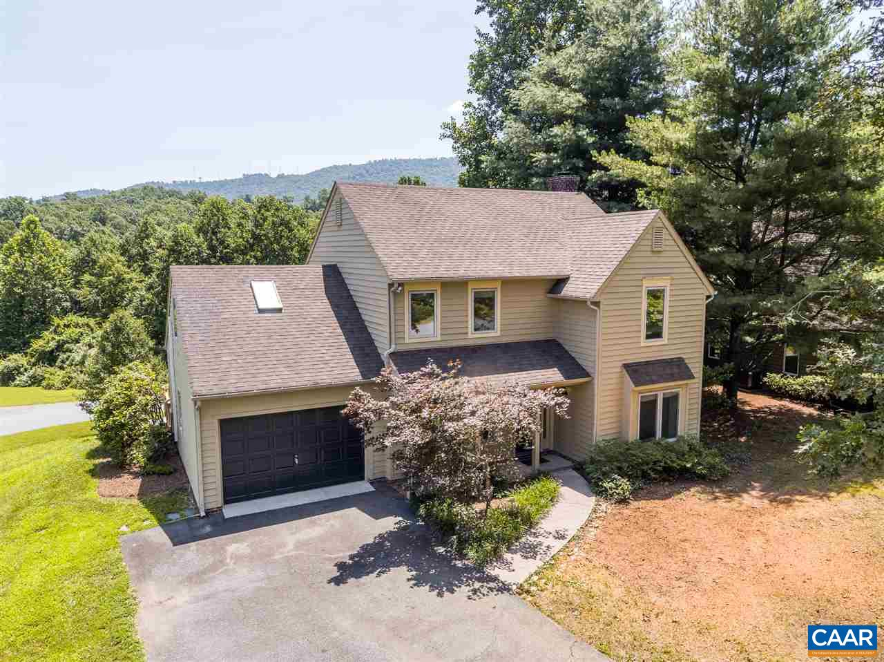 MILL CREEK SOUTH - MOVE-IN READY - LEVEL DRIVEWAY/ 'NO-STEPS' HOUSE ACCESS - CUL-DE-SAC STREET - WOODED VIEWS/SEASONAL CARTER'S MOUNTAIN VIEWS. 3 Bedroom, 2-1/2 Bath -  '93 Craig-built home w/ oversize 1-car garage & attic storage. Living room / dining room / family room w/wood burning fireplace. Owner's suite w/large flex space (office/study/crafts). Freshly painted interior. Relax-Entertain: 12' x 16' screened porch + 2 large decks (near ground level). NEW HVAC systems & NEW Water Heater. Casement windows w/ custom shades & cedar siding.  A HOME WELL WORTH YOUR CONSIDERATION!