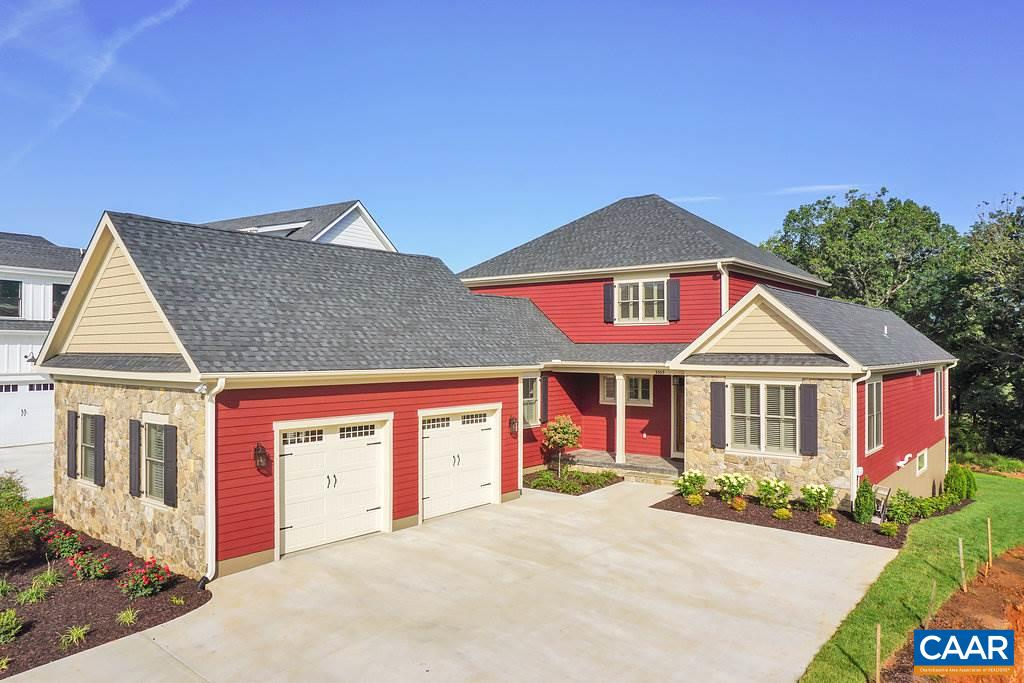 Rare opportunity to design & build a custom home on coveted Golf Course lot a stone's throw from the Old Trail Golf Club.  Quality materials and craftsmanship. Main level living with grand great room with vaulted ceiling and incredible stone fireplace. Chef's kitchen complete with exceptional cabinetry and commercial grade appliances. Gracious dining room. Two additional bedrooms and loft on second floor. Attached 2 car garage. Rear deck overlooks golf course.  Smart design, premium finish materials, workmanship and custom details throughout.