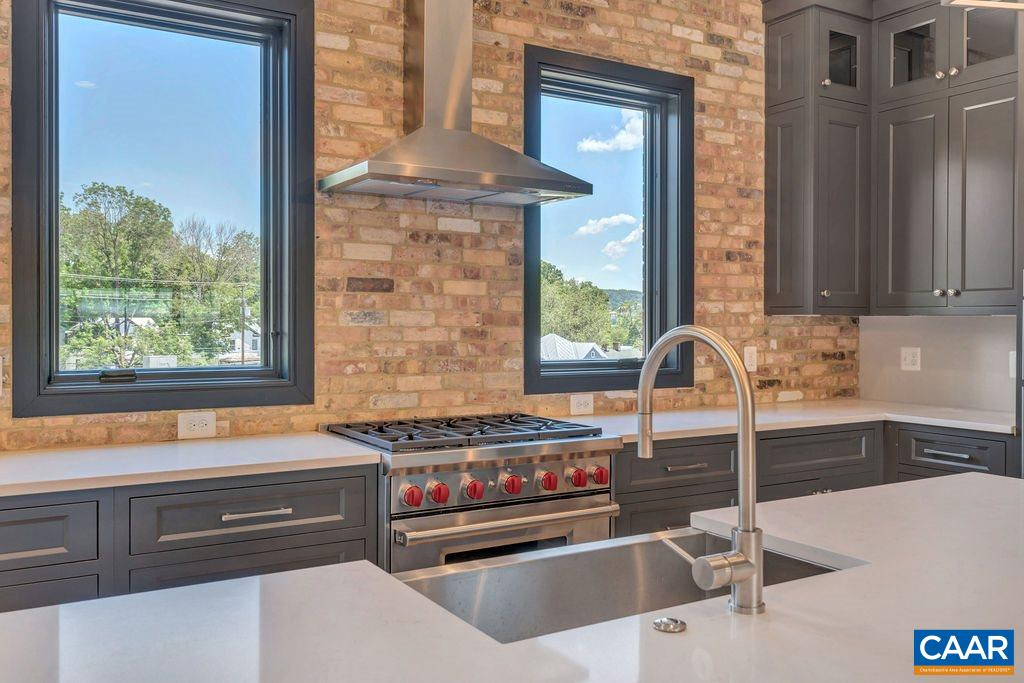 "ATTACHED BROWNSTONES DOWNTOWN.  C&O Row Phase III offering open concept smart design, private elevator, rooftop terrace with half bath,        pergola and 360 degree views, two car garage, all brick exterior w/ covered bluestone entry, 10' ceilings in great room and kitchen, open stair system from first floor to rooftop, oversized double hung Pella windows, finish in place white oak hardwood floors in all living areas, gourmet kitchen with 9' center island, 30"" Wolfe Range and Subzero refrigerator, spa like baths w/ designer tile surrounds & floors, steel tubs & full tiled shower enclosures, full floor master suite w/ walk in closets and study option, gas fireplace and bookshelves in great       room, extensive trim package."