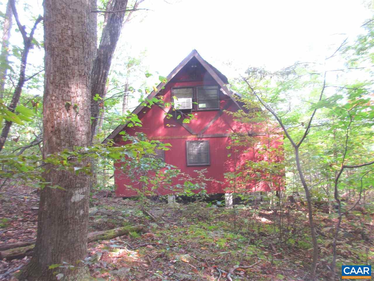 A great camping cabin high on a mountain information believed to be correct but not guaranteed.  Had electricity at one time but line fell down.  bathroom has old fashioned tub   also there is out house roof & siding in need of repairs.
