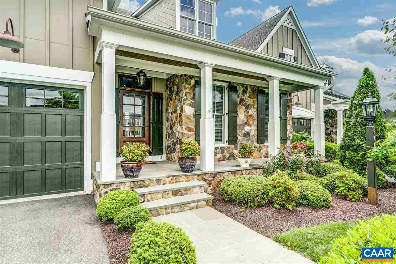 You'll love the sophisticated finishes, open, large light filled living spaces and beautiful millwork. Chefs kitchen with sleek finishes and butlers pantry area. Private main floor owners suite with spa-like bath and 2 closets. Spacious and open great room with stone fireplace and wall of windows overlooking pond and green space. 4 bedrooms with access to full baths! Expansive walk out terrace level with kitchenette and bar for easy entertaining. Covered patio off terrace level and spacious deck on main floor just off family room.  Golf villa with room for everyone, perfect for multi-generational living on 3 levels! Tucked away in developed area one block to the golf course. Walk/bike to award winning schools. Mountain and pond views!