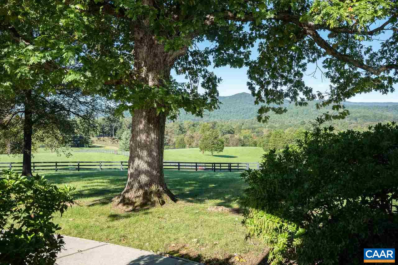 "An ideal contemporary on 17.6 park-like acres with unparalleled views in the heart of Free Union and Farmington Hunt Country. Nestled at the base of Buck Mountain this small farm comes with spectacular vineyard and mountain views. Fabulous one level living with an addition of a study/4th bedroom guest suite with private entrance by Greer & Associates in 2011. High ceilings, hardwood floors and a large stone fireplace in living room. 5-6 Paddocks and an updated 8 stall barn with climate controlled tack room, feed room and an indoor bay for shavings. Opportunity to build a riding ring. 2 shared ponds. 2 parcels. Great Property for a ""family compound."" Walking & Riding trails surround the property. Whole house/barn generator. Geothermal HVAC."