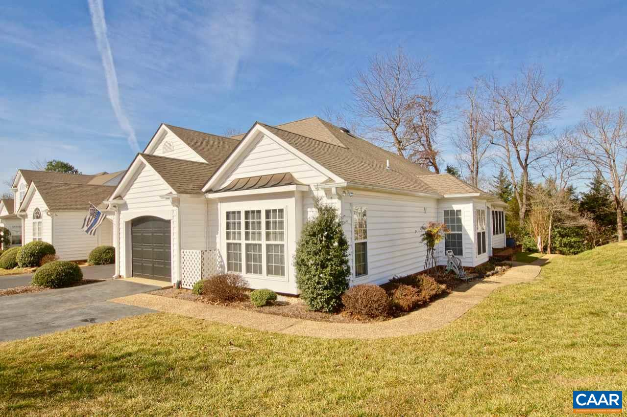 Carefree one level living in the Redfields community located just minutes from UVA and Downtown Charlottesville.  Featuring vaulted ceilings, wood floors , open floor plan,  home office / den and one car garage with private driveway.  Wonderfull sunroom opens to private backyard. Yard care, snow removal,  pool, playground and nature trails included in the HOA.