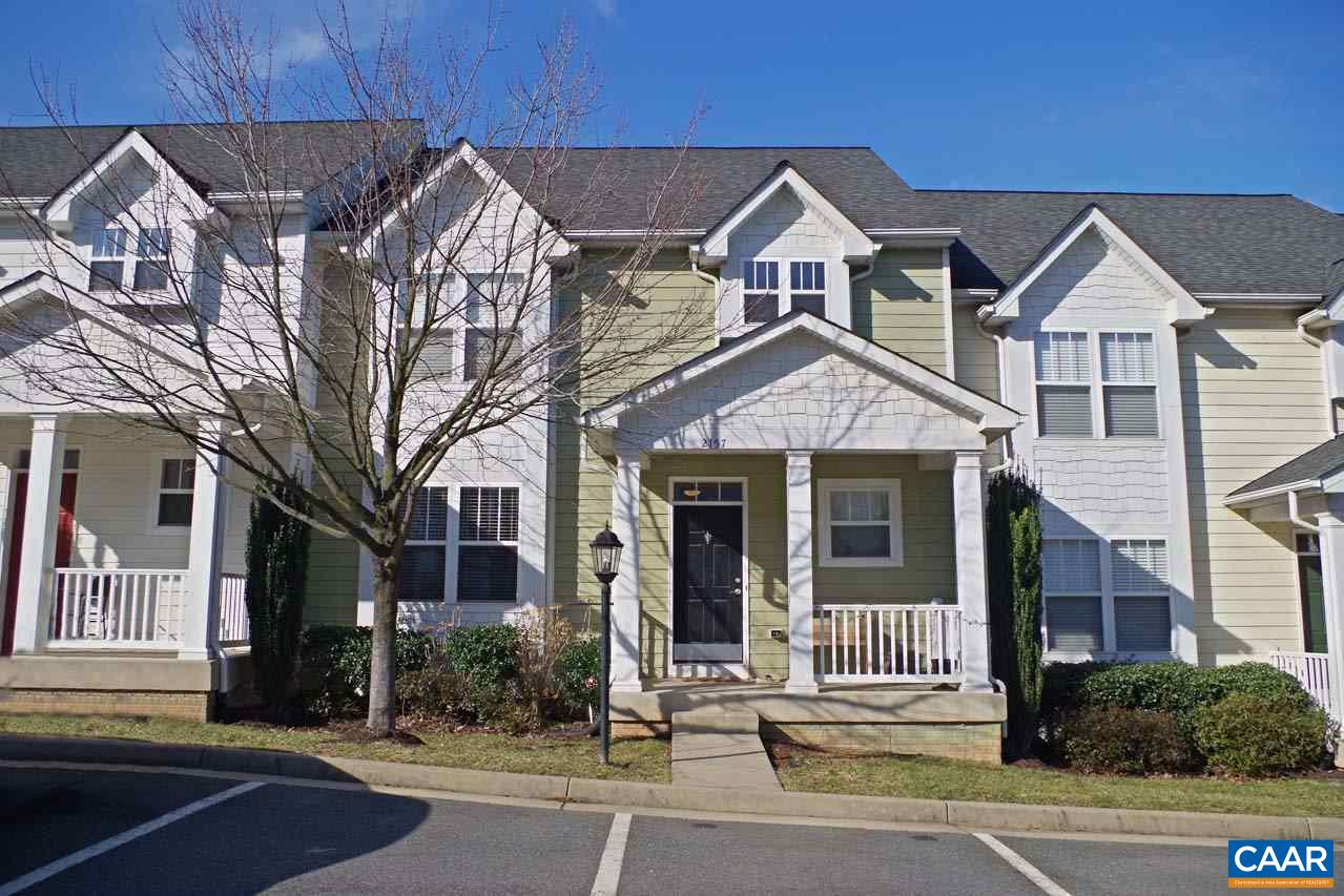 Exceptionally maintained & move-in ready in sought after Pavilions at Pantops! This home boasts almost 3,000 finished square feet, was originally the model & has many features including hardwood floors throughout the main level, open kitchen w/granite countertops, stainless appliances & a breakfast bar, master suite w/attached bath, 2 additional bedrooms, full hall bath & laundry closet on the second floor, a finished, walkout basement w/a home theater room, rec room, full bath & more. Enjoy entertaining on your deck w/Blue Ridge mountain views & the fenced-in backyard is perfect for a play area or pets! Located close to I-64, shopping, dining, MJ Hospital & more! HOA includes lawn care/landscaping, snow removal, play area & dumpster.