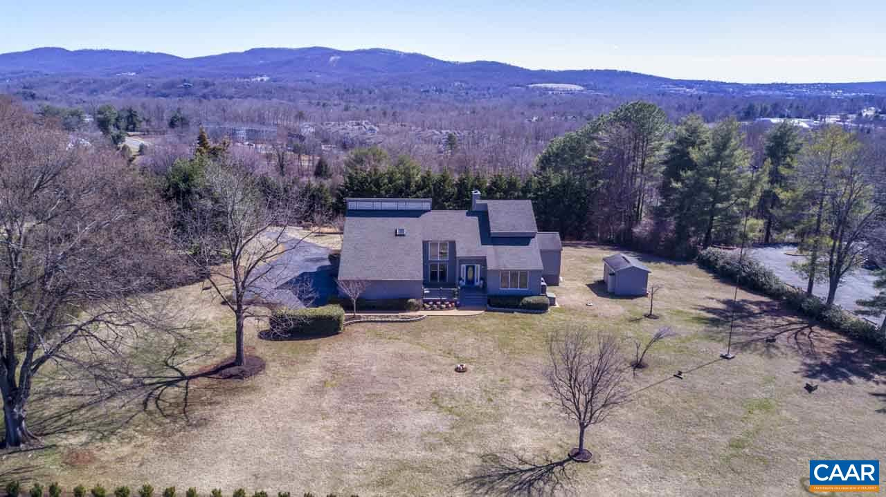 OPEN HOUSE SUNDAY MAY 19th  1 to 4   A rare opportunity contemporary home in albemarle co. but 2.66 acres  Northfields minutes to NGIC/DIA  or downtown or UVA. Incredible mountain views every windows  and a serene setting w/ panorama views. Unique open quality custom contemporary built by builder owner w/lots upgrades. 1st floor master bedroom suite plus  2nd master upstairs a total 4 bedrooms. Sunroom off kitchen to view the mountain & private setting.   Gourmet large eatin  kitchen w/desk &  stainless appliances.Great room w/ stone gaslog fireplace w/views &  living rm &  dining rm. Lower level w/ huge rec rm & 1/2 bath & workshop.  Garage & basement finished  also Priced sell below assessment. Immaculate unique home.