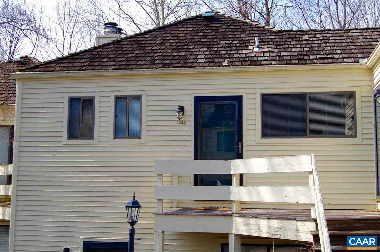 Adorable updated 1 bedroom condo in the desirable neighborhood of RiverRun.  Updated look with great flooring, wood-burning fireplace, Vaulted ceilings, private deck with rear view of woods. No maintenance living! Awesome community with pool. Minutes to downtown, UVA, Shopping and dining.  Incredible location!