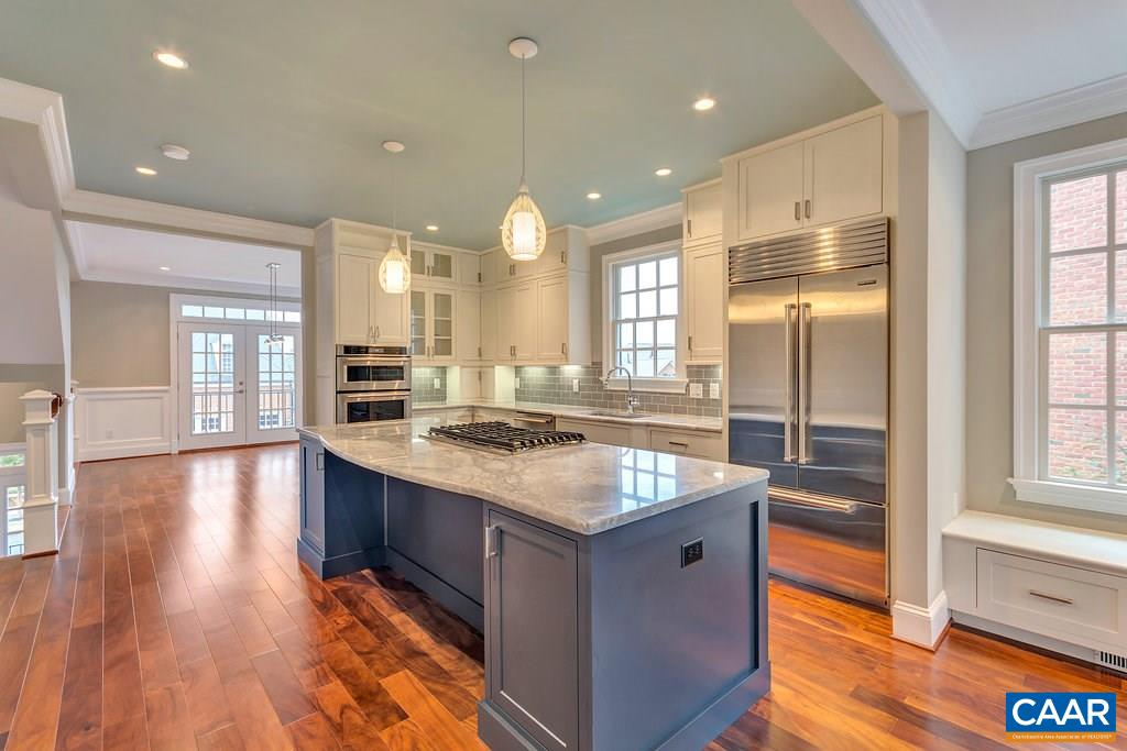 "Don't miss this unique opportunity to obtain a stately brick townhome featuring fine finish details in ""Kenridge"" where you live in the middle of everything - minutes from UVA, Boars Head and Birdwood, and Farmington Country Club. Only 2 townhome lots remain unsold in ""Kenridge"". Three-level living features an elevator (installed), formal and informal spaces plus generous room sizes and closet space plus a Garage. Gleaming interior bathed in natural light. Tile and cabinetry selections are top notch. Full Kitchen appliance package plus Island. Three-zone HVAC. Duel fuel on 1st & 2nd floors. Heat pump (only) on 3rd floor. Overview of Cannon Properties (Builder), floor plans, interior finishes and allowances plus exterior specs attached."
