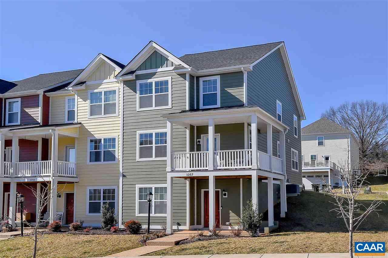 Spacious 4 bedroom 3 1/2 bath end unit townhome in Crozet's convenient and popular Haden Place! 2466sqft of finished space is the best townhome value in Crozet! Bright & open floor plan w/large windows, 9' ceilings & hardwood floors. Fully featured kitchen w/storage galore, granite counters, stainless appliances. Awesome front deck perfect for relaxing & entertaining. Generous master bedroom w/3 windows and attached fully tiled bath. 2nd floor laundry. Lower level bedroom, full bath and family room. Earthcraft certified & low HERS score (62) keep utilities costs low. Incredible Crozet convenience, walk to library, restaurants, coffee shops, pools, ACAC & YMCA, and more! Western Albemarle schools. Perfect family home or investor property.