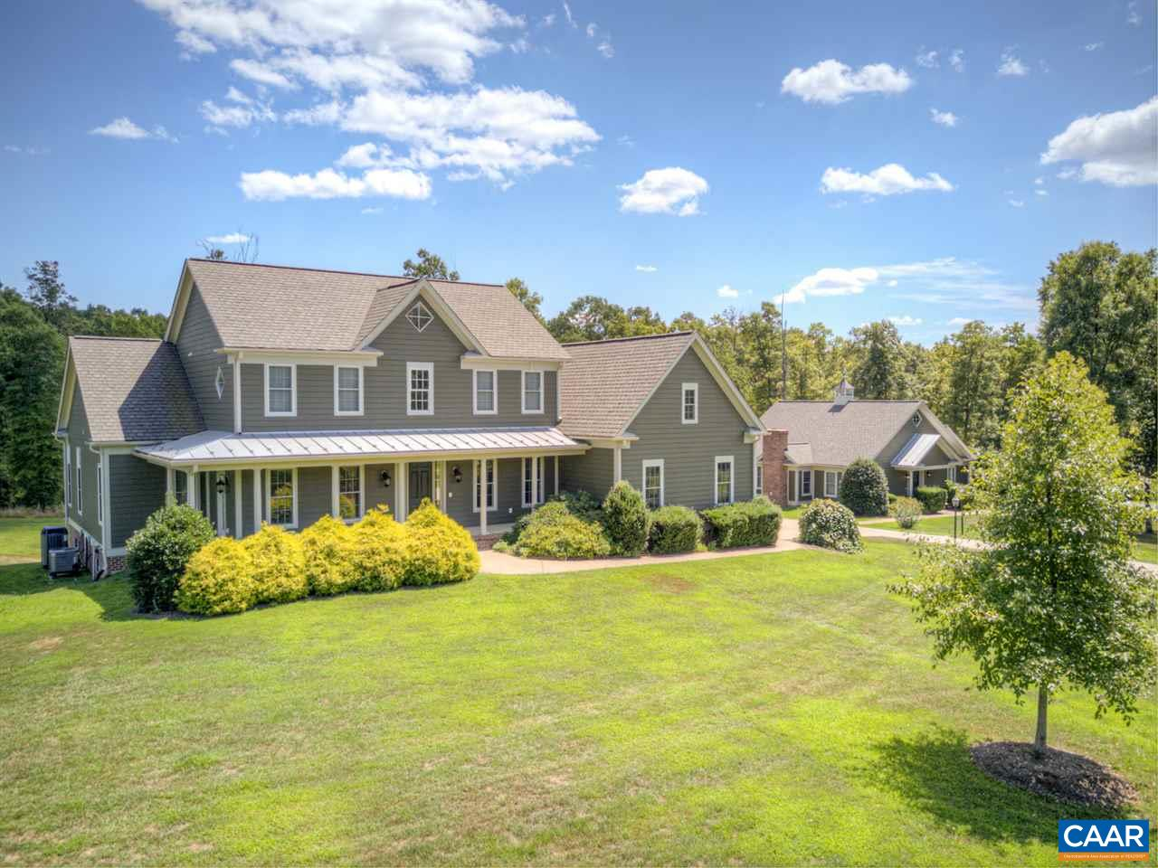 Beautiful home and situated within a short commute to Charlottesville. Discover the peace and tranquility of Llama Farm Road. This stunning location offers a country setting on your private 24+ acre retreat. Complete with Redbuds, Dogwoods, and an orchard and a multi-functioning cottage. The home has a spacious dining area perfect for entertaining and socializing. The modern hardwood floors complement the floor to ceiling custom built cabinetry. Situated next to the main residence you will find a cozy cottage great for a mother-in-law suite, a possible home for your never-left home or returning child, or a great studio/office. Landscaping, paved driveways, and a whole house generator complete this incredible offering.