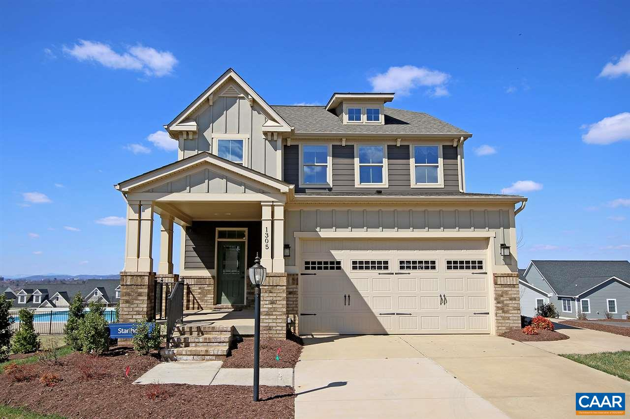 This beautiful 4 bedroom Cascadia home is located minutes from Sentara MJH, the 250 bypass, & I64. The community also offers convenience to downtown & the University of Virginia. This 3,555 finished sqft home features light-filled & open spaces, hardwood flooring throughout the main level, a rear deck with Blue Ridge mountain views, a stone patio with fire pit, & an attached 2 car garage. The home boasts both formal & everyday spaces - LR with stone surround fireplace, kitchen with granite counters & ss appliances, dining room, home office, MBR suite with a private bath & walk-in closet, full size washer/dryer on the bedroom level, & a finished walk out basement. Enjoy the community clubhouse & pool located just steps away!