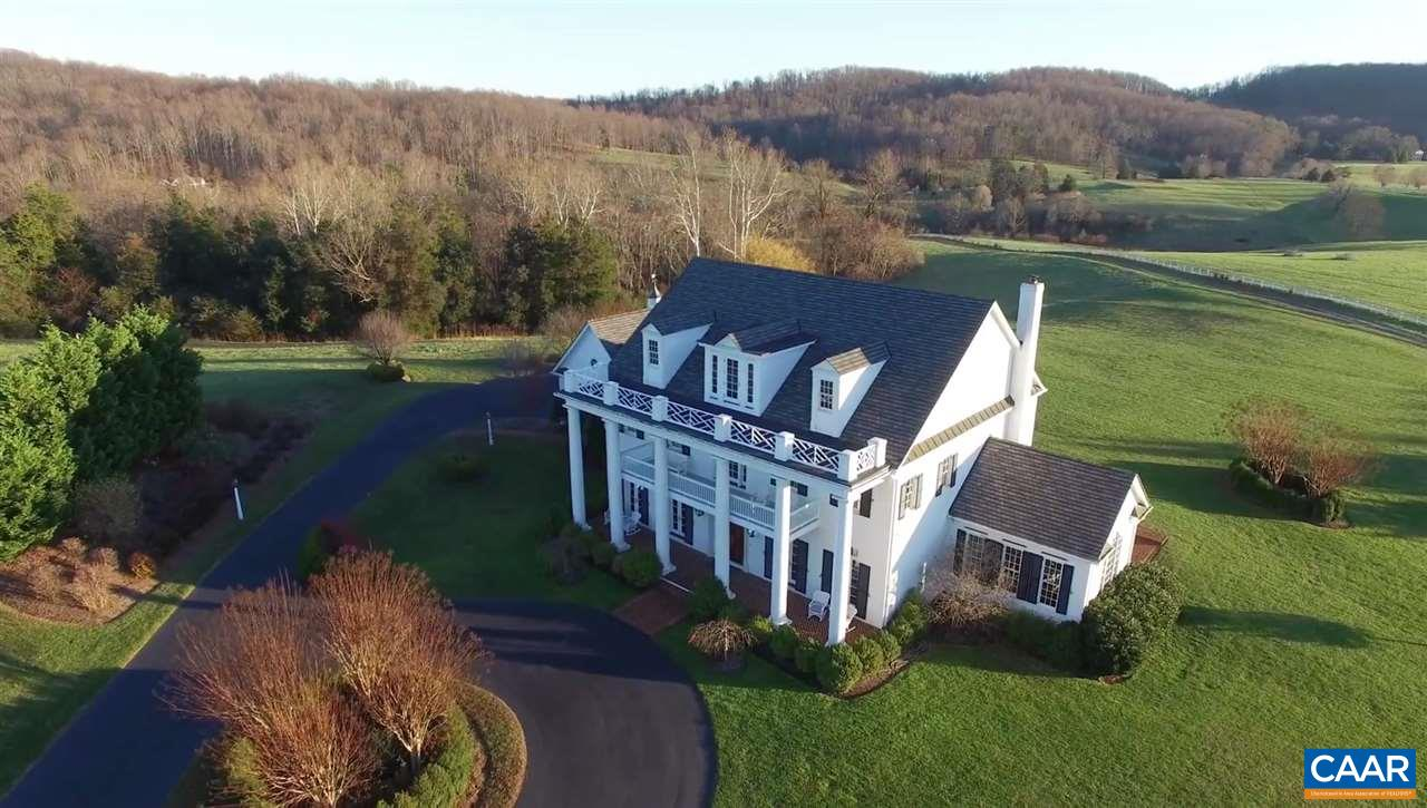 Sited on 21 acres to enjoy stunning pastoral & mountain views, this distinguished yet welcoming brick home offers a coveted Ivy address in the Western school district w/ extraordinarily speedy access to all of Charlottesville. 11 ft ceilings & amazing natural light from french doors & floor-to-ceiling windows enhance the natural drama of the 1st floor living & entertaining spaces. Adjacent acreage & views permanently protected by conservation easements. Add'l attributes include a 3 car garage, extensive use of herringbone brick at the front & side porches & walkways, rear terrace & screen porch, 3 fireplaces & the ideal balance of casual & formal living spaces.  The acreage offers rolling, open hills framed by mature hardwoods & the views!