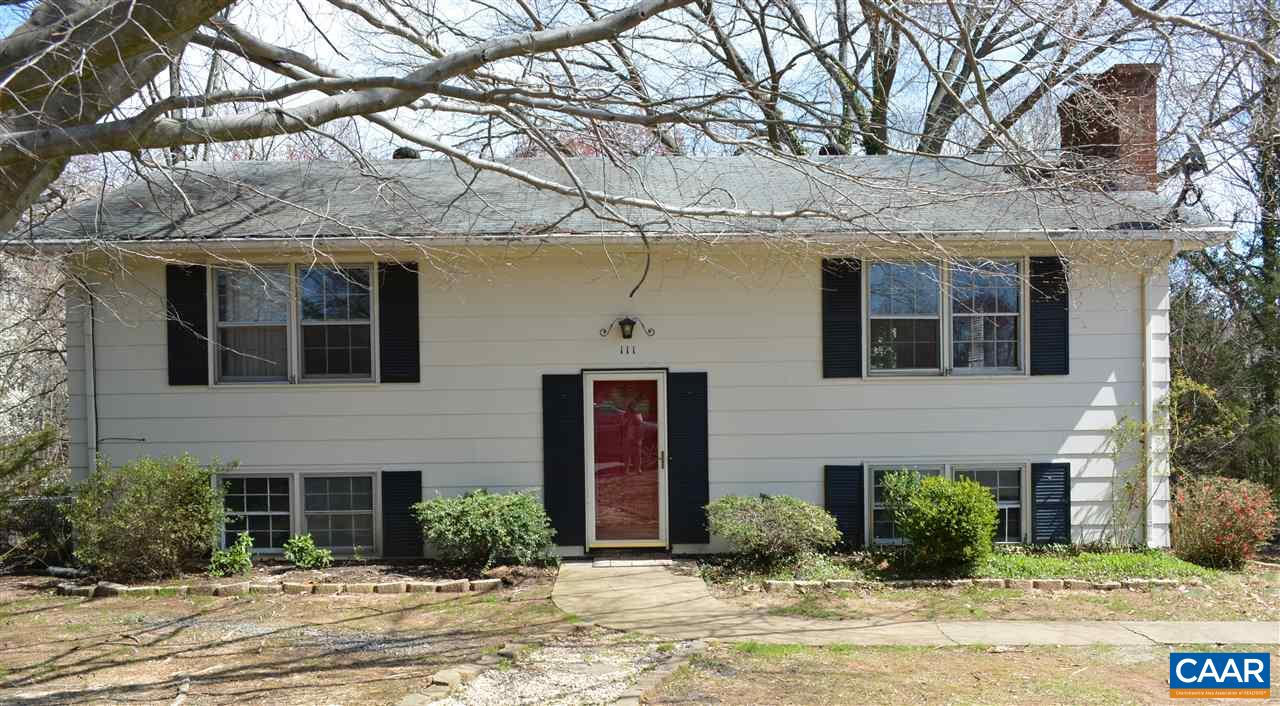 Great fixer upper close to Hollymead Town Center.  Home needs a little cosmetic updating.  Hardwood floors on upper level, wood fireplace in living room and wood stove in family room.  Beautiful fenced in lot with very mature shade trees.  Paved driveway. Sold in as is condition.