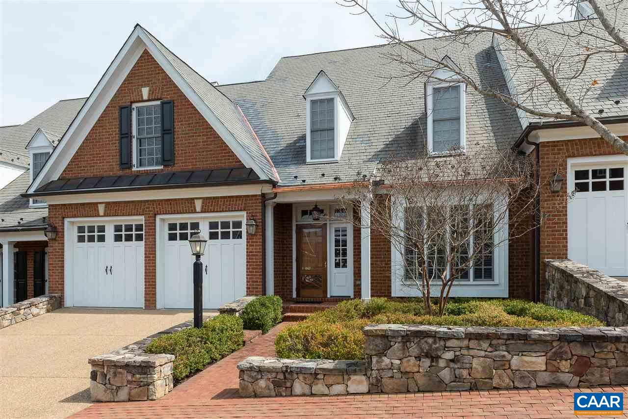 Elegant Kenridge villa offers easy one-level living in excellent Ivy Road location steps from Birdwood Golf Course, Farmington CC, Boar's Head, and UVA. Incredible Chef's kitchen opens to a cozy breakfast area and living room with vaulted ceiling and wall of windows. Main level master bedroom suite with luxurious spa-like bathroom, dining room, sunroom, study/library, laundry room, and powder room round out the first level. Three en suite bedrooms and storage complete the second level. Finished lower level includes family room with bar, a fifth bedroom or office, full bath, and exercise room. High-end finishes and details throughout: coffered and tray ceilings, wainscoting, hardwood flooring, built-in bookcases, just to name a few!