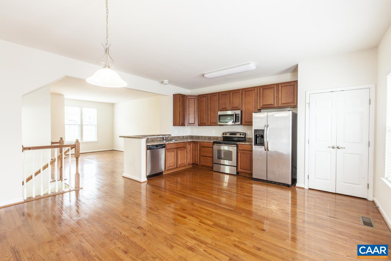 INCREDIBLE VALUE IN PANTOPS AT PAVILIONS UNDER 280K!  Meticulously maintained 3BR/2.5BA w/ over 1700 finished sq ft. Main level open floor plan and attached garage. PRIME LOCATION on Pantops with close proximity to Martha Jefferson Hospital, Downtown, UVA, I64 & RT 250. Features maple cabinets, stainless steel appliances, hardwood floors, tiled basement, carpet in bedrooms and recently painted. Back deck is perfect for a grill w/ access to kitchen and provides nice mountain views. HOA provides play area, basketball court, trash services, area maintenance, yard maintenance and professional management. Basement is pre-wired for surround sound or home office. This home offers an exceptional value and will not last long!