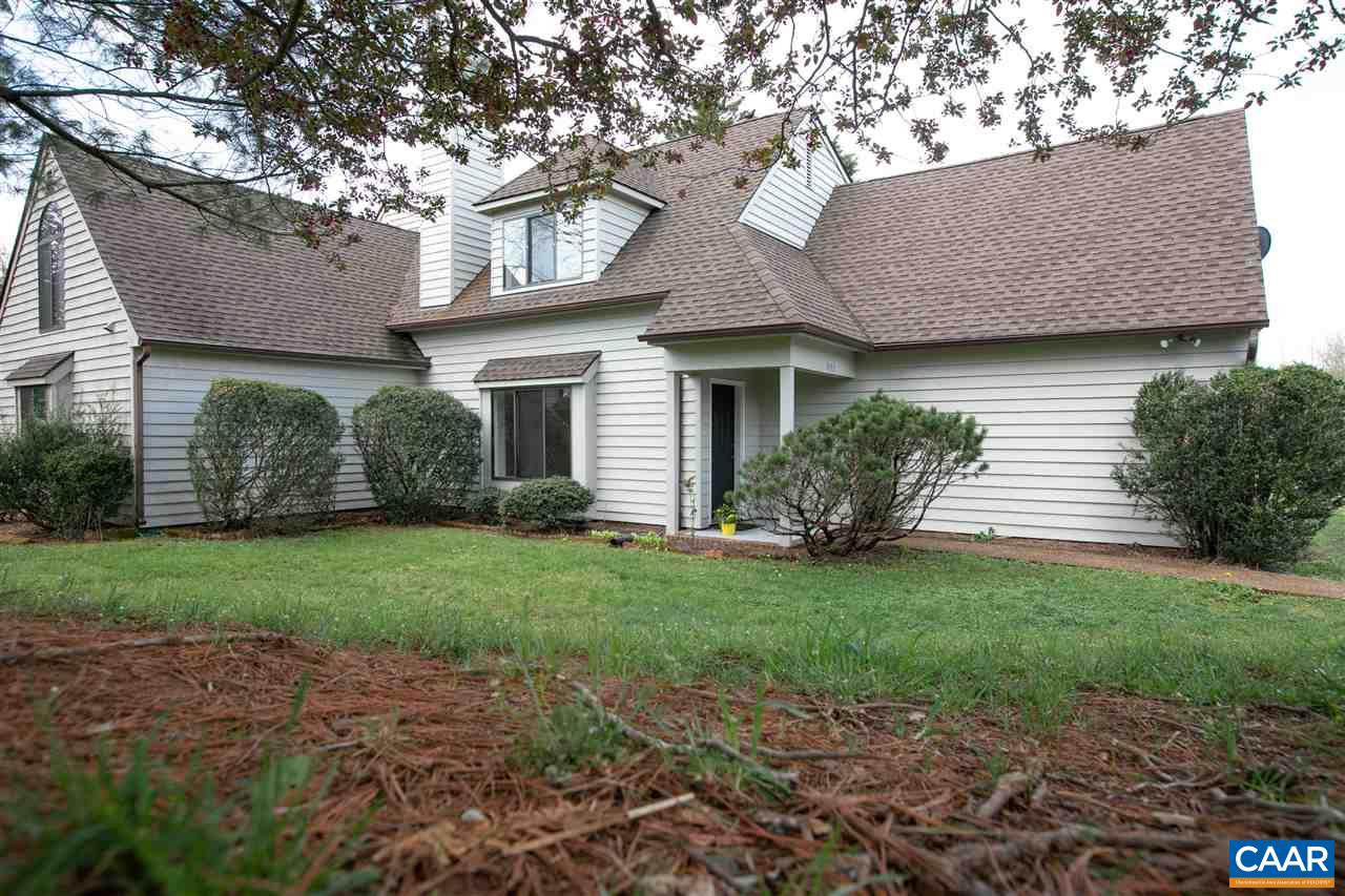 Recently updated attached home in the Highlands neighborhood features freshly painted interior and exterior, new carpet and new flooring in all baths and kitchen.  Open concept main level offers living area with fireplace, kitchen and dining area. A sliding door opens to patio area and beautiful backyard with wooded views. Spacious first floor master bedroom with ensuite and large closet. Second level offers 2 generous bedrooms, a full bath, laundry and a flexible bonus space for an office area, playroom or 4th bedroom. Great Value in the Western Albemarle school district!