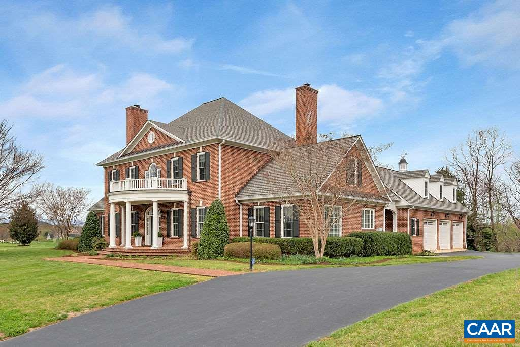 This distinguished Baird Snyder-constructed, all brick Georgian offers Blue Ridge views in a coveted, close-in, Western Albemarle location minutes from schools, conveniences, UVA & the vibrant downtown area.  Understated yet sophisticated interior design selections include stone, tile & paint colors that are all light, bright & in step with today's design aesthetic.  The screen porch off the family room & 1st floor master suite overlook a private garden & expansive, level side lawn. Additional features include a walnut paneled office or library, formal & informal half baths, hardwood floors throughout, full, unfinished basement w/ bathroom & 3rd fireplace rough-ins, 3 car garage. Murray Elementary School.  Under 10 mins. to everything.
