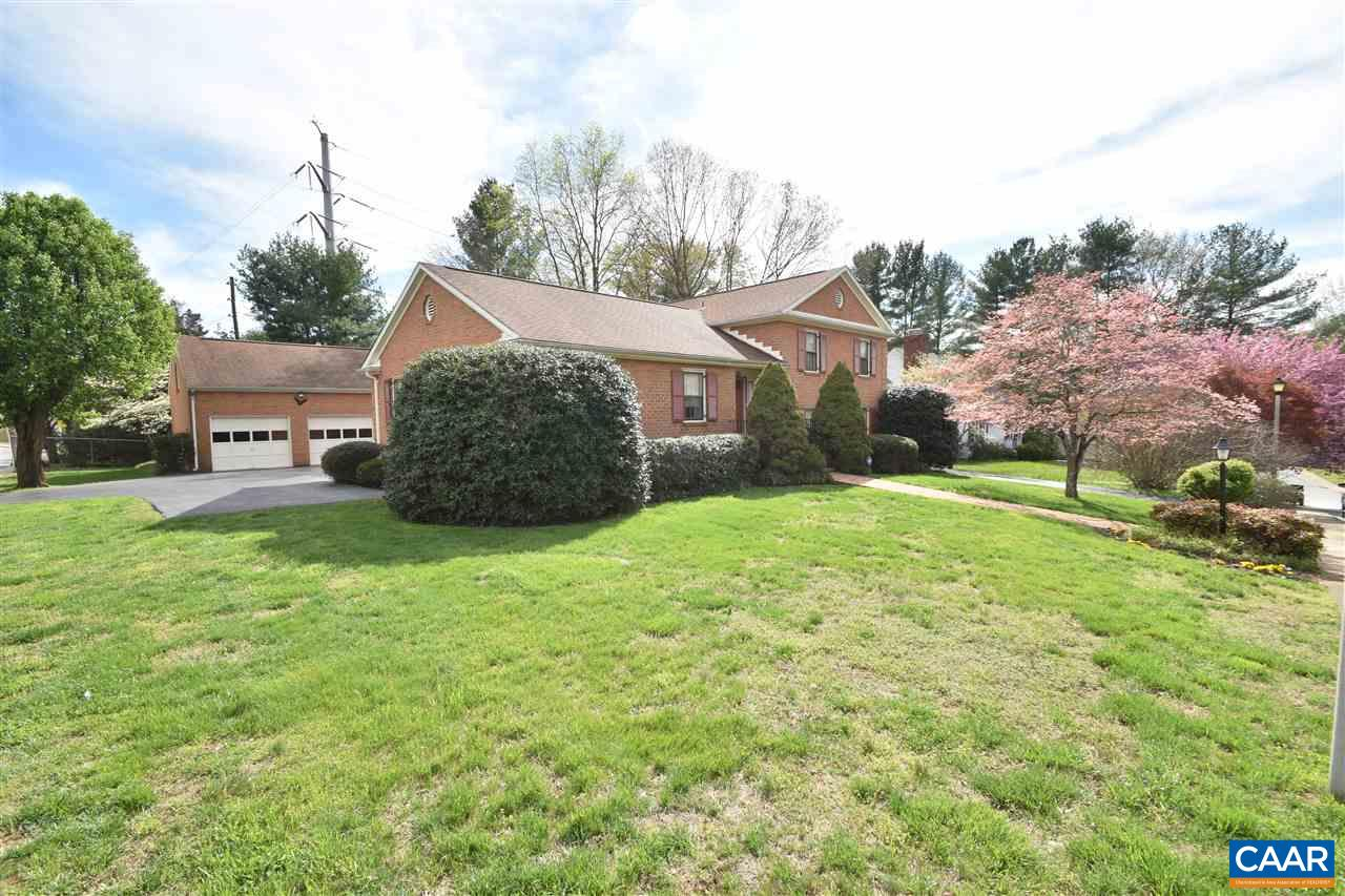 Open House Sunday 4/14 from 1-3pm. First time on the market. Premier location in Charlottesville. Beautiful corner lot on Grove Rd.  Walk to CHS, YMCA, Rivanna trail, Tom Sox and more.  Massive detached garage with walk up access to area above garagefor storage or can be transformed to loft office or work shop. Home features hard wood floors, large rooms, updated kitchen & appliances, 4 beds, 3 full baths.  Wonderful rear screened porch over looking private back yard. Master suite has an observation deck that allows front row seating for McIntire Park July 4th fireworks. Two driveways. All brick construction. Well maintained home. Tremendous potential and future value for next owner. Wet bar in basement. Great In law/rental suite potential.