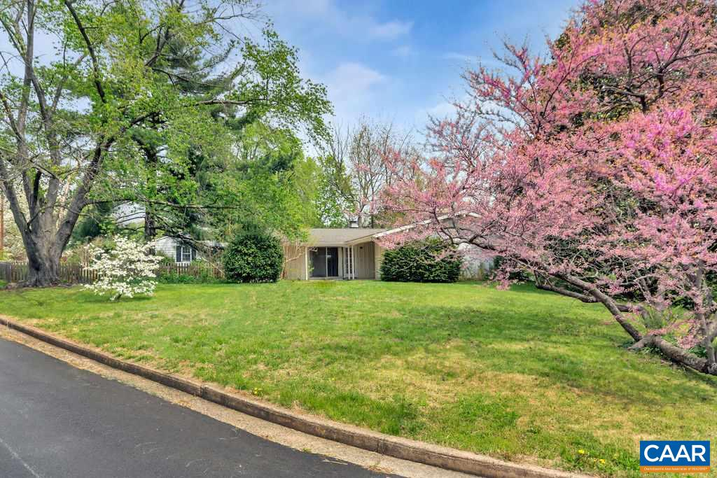 Right in the heart of Charlottesville, a compelling, mid-century modern offering lots of open space and an abundance of understated cool. Situated on a large elevated corner lot, this home features three bedrooms including a Master, three full baths with original tile-work, a full, partially finished basement, renovated kitchen with stainless appliances, incredible hardwoods throughout the first floor and a wealth of  natural light courtesy of many large windows, some floor to ceiling, as well as the slider to the rear stoop.  Outside, is the concrete drive, partially fenced yard for the pups and a single car garage connected to the main house by a short breezeway.  Centrally located and just minutes to Stonefield, Shoppers World and Rt 29.
