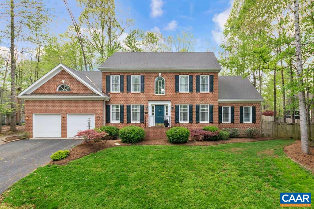 Brick front home on a premium lot in Dunlora. First floor master bedroom, with large beautifully renovated master bath with glassed walk in shower, dual vanities. Family room with gas fireplace (can be woodburning) cathedral ceiling, skylights and upper windows to allow lots of natural light. White kitchen with granite counters and breakfast bar, plenty of cabinet storage, and opens to an oversized breakfast room with walls of windows and views to the professionally landscaped fenced backyard and outdoor entertaining patio. Second floor offers 3 bedrooms, two share one full bath, third bedroom has its own attached full bath. Two car oversize garage. Dunlora offers many maintained walking trails to the Rivanna River. Home is move in ready!