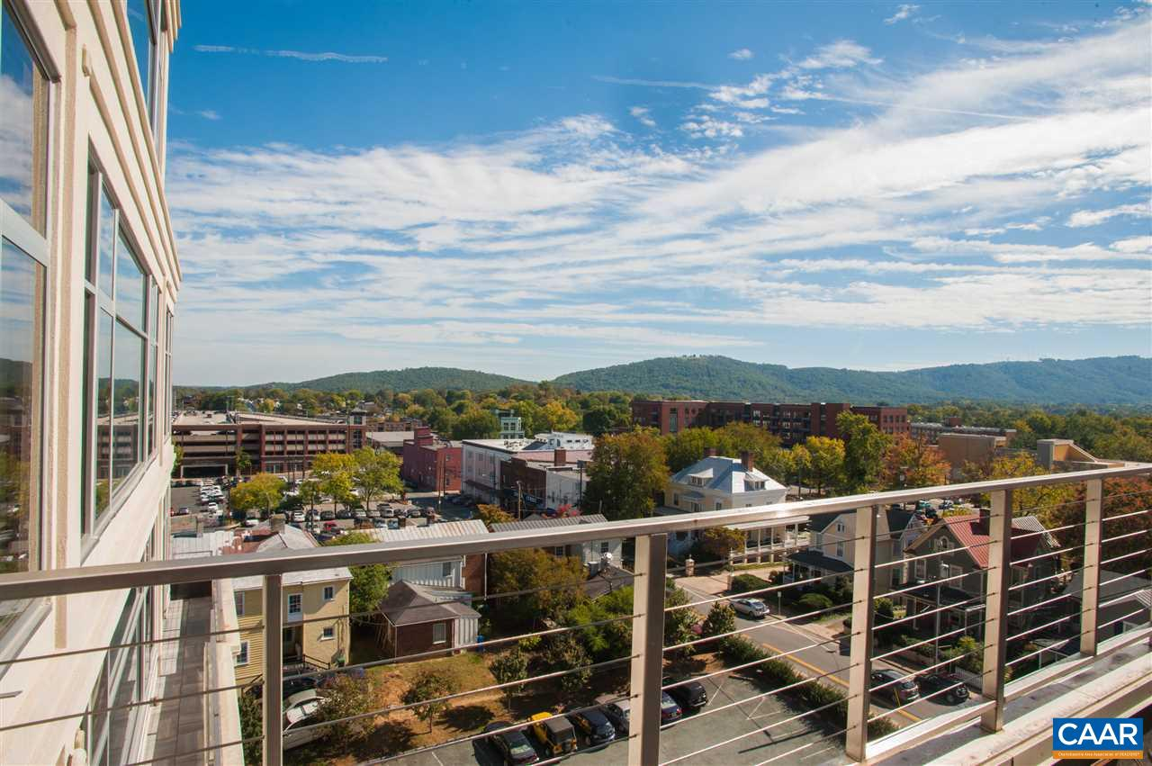 This spacious and bright one bedroom condo with mountain views offers a unique opportunity to design your perfect home. With a terrace off the master bedroom, you can enjoy views of Downtown Charlottesville as well as both Carter & Brown Mountain. Floor to ceiling windows accentuate the amount of space you have to make your very own as it is being offered in core & shell condition, allowing for maximum customization. With easy walking distance to the Historic Downtown Mall, you are just steps away from an abundance of restaurants, shops, and entertainment. You have to see this stunning condo in the most desired location in all of Charlottesville!
