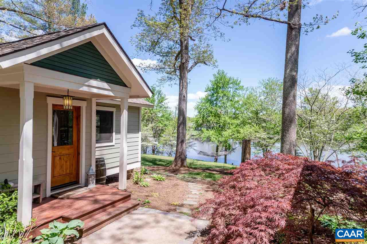 LIVE LIKE YOU ARE ON VACATION! Do not miss this wonderfully renovated lake front home.This retreat sits on a lovely one acre lot with a private dock. Recently remodeled one level home with its own detached guest cottage. Main home features Hardie-plank siding with beautiful stone accents, extensive low maintenance landscaping, a large deck and a view that can't be beat. Inside you will find an open floor plan with expansive views of the waterfront and vineyard beyond. Special features include:Brazilian Cherry flooring, ceramic tile, concrete counter tops, stainless appliances, wooden, deep-sill high efficiency windows, master bedroom with fireplace, and a screened sleeping porch. The cottage features  large family room, loft and bath
