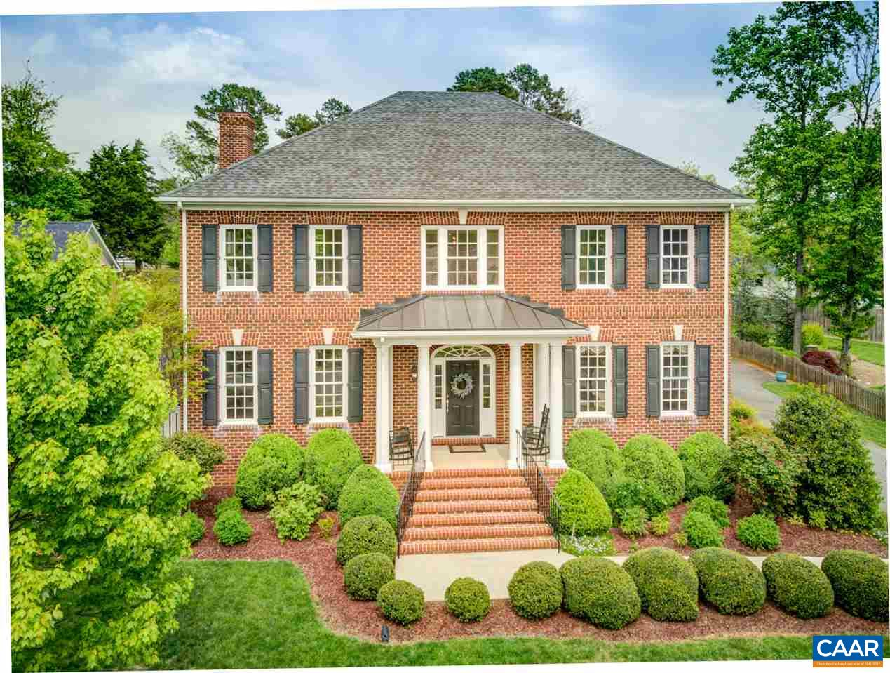 A perfect combo of traditional elegance and modern luxury, this all-brick Colonial has a grand foyer that flows into the formal dining room, stately office with custom millwork and spacious family room with a wall of windows that looks out to a true backyard oasis that is one of Old Trail's most level and private. The gourmet kitchen with granite tops, maple Shaker cabinets and Bosch stainless appliances opens to the covered patio for the ideal indoor/outdoor flow. The luxurious master suite retreat offers a sitting room, her/his closets and marble vanities. A rear staircase rises above the full 4-car garage to the theatre room, rec room and full bath. Situated on a cul-de-sac with minimal traffic and peace of mind for safe kid's play.